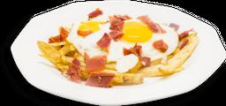 Huevos Rotos con Jamón Serrano