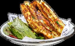 Combo 2: Grilled Cheese con Aguacate + Jugo de Naranja
