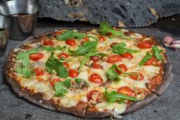 Pizza de Jitomate Cherry y Ajo con Hojas de Arúgula